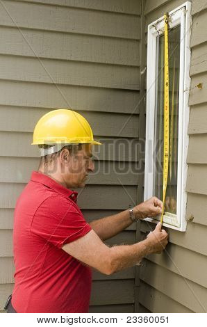 Carpenter Measuring Window Repair