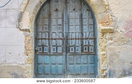 Vintage, medieval door Spanish city of Segovia. Old wooden entrance. ancient architecture