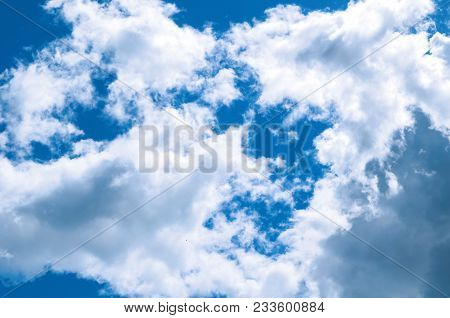 Sky Landscape Of Cloudy Sky. Blue Sky Background With White Dramatic Clouds And Sunlight In The Sky.