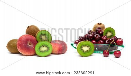Cherries, Kiwi And Peaches On A White Background. Horizontal Photo.