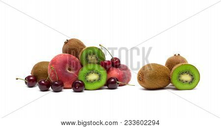 Ripe Cherries, Kiwi And Peaches On A White Background. Horizontal Photo.