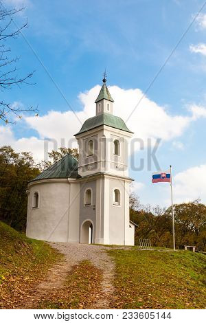 National Cultural Monument Rotunda Of St. George With The Flag Of The Slovak Republic Waving On The