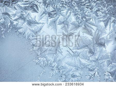 Frost pattern on window glass, closeup