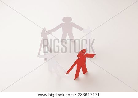Closed Joining Of Five Paper Figure With Red One In Hand Down Posture On Bright White Background. In