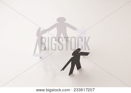 Closed Joining Of Five Paper Figure With Black One In Hand Down Posture On Bright White Background.