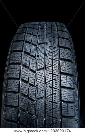 Clean Tyre. Black New Shiny Car Tire Background.