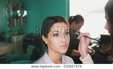 Make Up Artist Doing Professional Make-up Lips For Beautiful Girl, Close Up