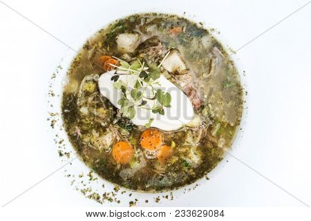 Fine dining cuisine - french dish soup on the table