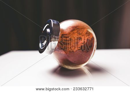 Chili Pepper In Glass Jar On Kitchen Desk Isolated