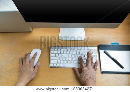 Top View Of Closeup Hand With Weir Wrist To Working With Computer Keyboard With Mouse And Technology