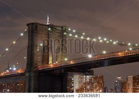 Side View Of Brooklyn Bridge At Night