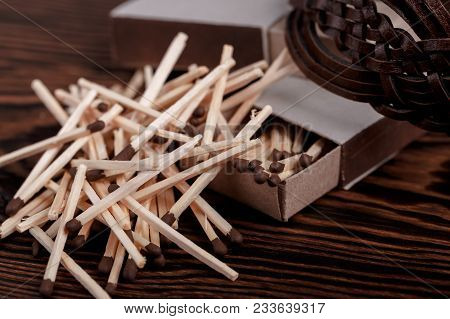 Matches In Open Match Box On Wood Background