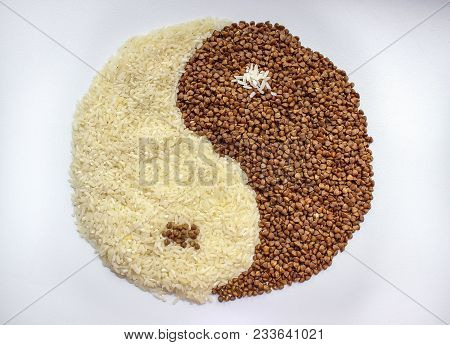 The Symbol Of Yin Yang Is Laid Out Of Buckwheat And Rice, Texture.