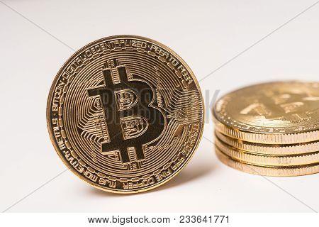 Bitcoin Blockchain  Btc Concept. Golden Bitcoin Coins As Symbol Of Electronic Virtual Money