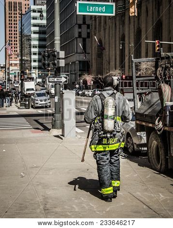 Detroit, Michigan, Usa - March 22, 2018: Detroit Firefighter Walking Down A City Sidewalk After Resp