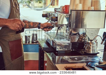 African-american Barista Making A Coffee With The Professional Coffee Machine, At The Coffee Shop.