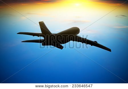 Passenger Plane Flying In The Sky At Sunset
