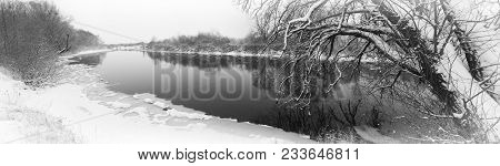 Winter River. A Winter River Landscape With Snow-covered Banks.