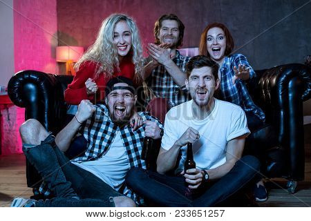 Group Of Friends Having Fun At Home, Watching Game And Enjoying Together. Winners Friends Are Fans O