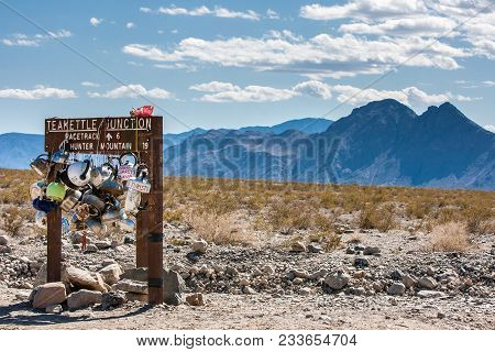 The Sign At Teakettle Junction Showing The Way To The Racetrack In Death Valley California