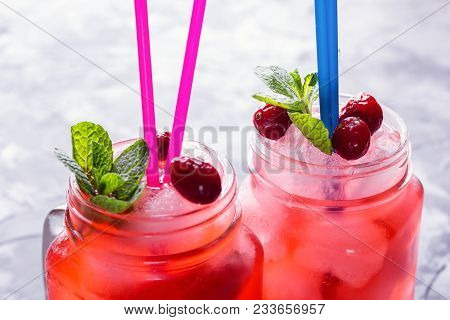 Berry Morse, Cocktail Of Currant And Cowberry With Ice And Fresh Mint Leaves, With Powdered Sugar In