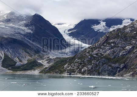 The Scenic View Of A Coastline With The Little Glacier Trapped Between Mountains In Glacier Bay Nati