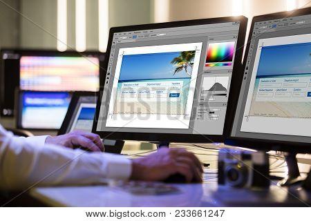 Designer Working On Multiple Computer Screen