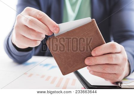 Men In Suit With Wallet And Credit Card. Selective Focus Of Credit Card In Brown Leather Wallet. Bus