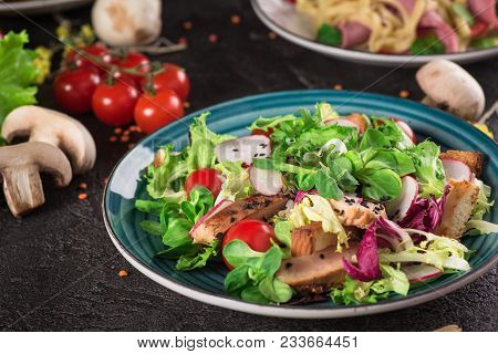 Fresh Vegetable Salad With Grilled Chicken Breast - Tomatoes, Radish And Mix Lettuce Leaves. Chicken