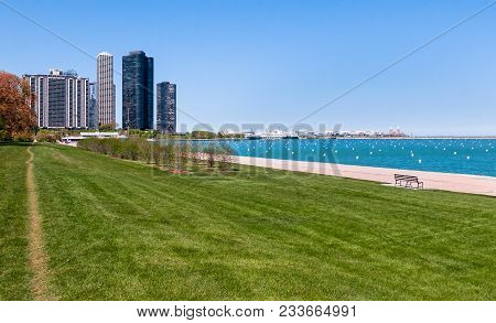 Harbor Point View With Condominiums In Background On The Shore Of Lake Michigan In Chicago Downtown,