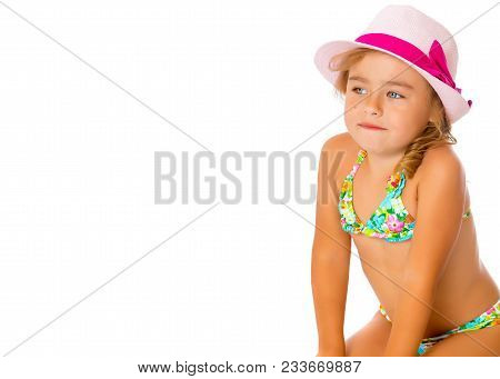 174216a2a8aa Beautiful Little Tanned Girl In A Swimsuit And A Hat. The Concept Of Summer  Family