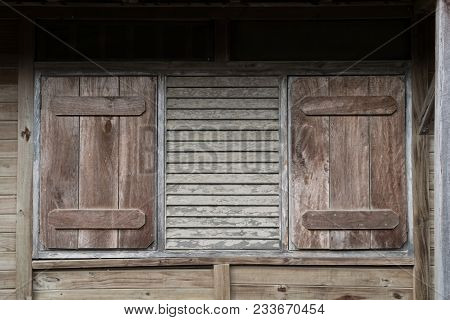 Window With Closed Shutters - Wooden Building Exterior With Closed Shutter -