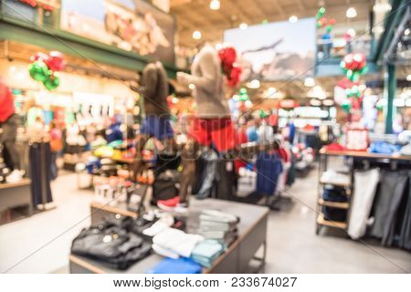 Blurred Interior Of Sports And Fitness Clothing Store In America