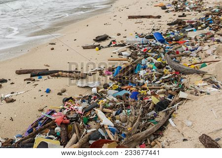 Polluted Beach  - Plastic Waste, Trash  And Garbage Closeup -