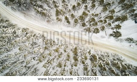 Aerial View Of Winter Road. Winter Landscape Countryside. Aerial Photography Of Snow Forest With A C