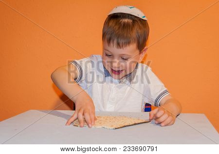 Happy Little Jewish Child With A Kippah On His Head Playing With The Matzo Bread. Passover Illustrat
