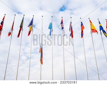 View From Below Of Flag Of Russia Flying Half-mast At Council Of Europe As A Tribute And Mourning Of