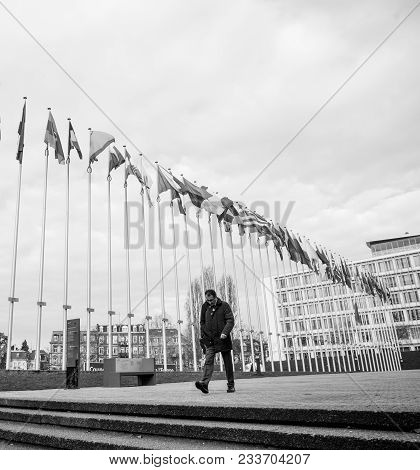 Strasbourg, France - Mar 29, 2018: Worker Under Flag Of Russia Flying Half-mast At Council Of Europe