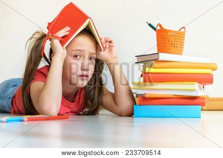 Difficulties In Study. The Tired Child Doesn't Want To Study. A Stress In Training
