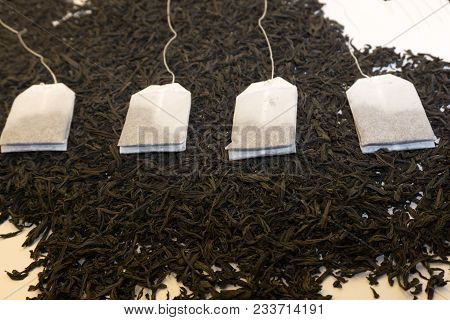 Tea Bag Laying On A Bed Of Tea Leaves