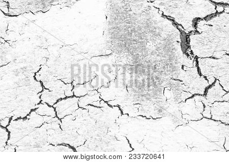Black Cracks On White And Gray Background. Gray And White Background. Barren Earth. Dry Cracked Eart