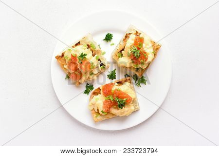 Healthy Snack. Scrambled Eggs, Tomato, Green Onion On Bread Over White Background. Top View, Flat La