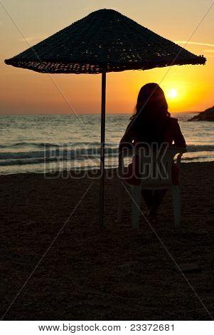 Woman On Beach Admire Sunset