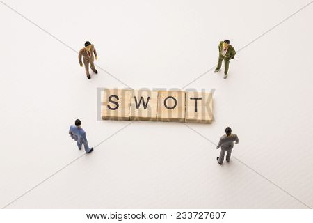 Miniature Figures Businessman : Meeting On Swot Letters By Wooden Block Word On White Paper Backgrou