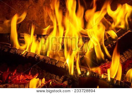 Log Fire In A Fireplace. Burning And Glowing Pieces Of Wood In Fireplace.