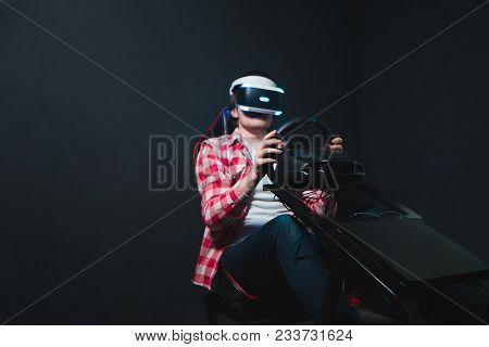 Gamer Plays The Race On The Car Simulator In The Vr Headset. Video Games In The Vr Headset. Computer