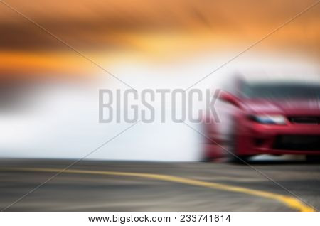 Abstract Blurred Car Wheel Drifting And Smoking On Track. Sport Car Drift Concept.