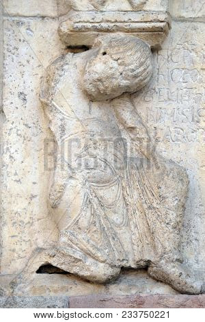 MODENA, ITALY - JUNE 04: Plate with stories from Genesis: Story about Abel and Cain, detail of relief by Wiligelmo, Modena Cathedral, Italy on June 04, 2017.