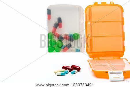 Orange Pills Box With Colorful Capsule Pills Isolated On White Background With Copy Space. Prepare M