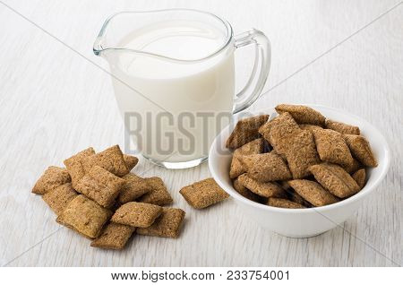 Heap Of Cereal Pillows Jug Of Milk, Bowl With Pillows On Wooden Table